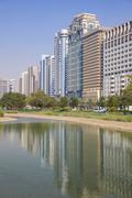 City center buildings reflecting in corniche lake, abu dhabi, united arab emi Stock Photos
