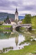 church of st.john the baptist (sveti duh church), lake bohinj, triglav nation - stock photo