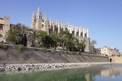 cathedral of santa maria of palma (la seu), parc de la mar, palma de majorca  - stock photo