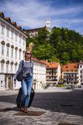 Tourist with suitcase, ljubljana, slovenia, europe Stock Photos