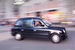 Motion blurred black taxi, piccadilly circus, london, england, united kingdom Stock Photos