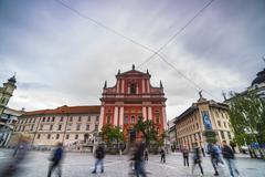 tourists in preseren square (trg) and the franciscan church of the annunciati - stock photo