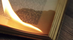 Burning edge of an antique book - stock footage