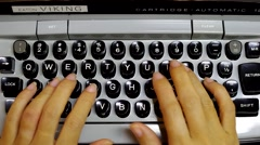 A woman typing on an old, vintage, electric typewriter. Stock Footage