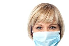 Stock Photo of Female doctor wearing surgical mask