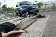 Casualty in blood on the road Stock Photos