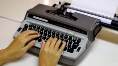 A woman typing on an old, vintage, electric typewriter. - stock footage