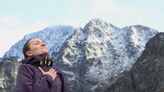 Young woman breathing fresh air in winter mountains, Tatras, Slovakia HD Stock Footage
