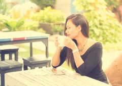coffee. beautiful girl drinking tea or coffee in cafe. beauty model woman wit - stock photo