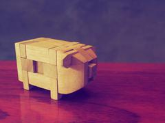 wooden pig in vintage color - stock photo