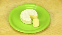 Camembert rotates on a wooden board - stock footage