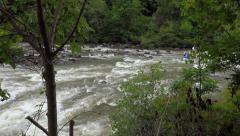 White water rafters  navigating rapids - stock footage