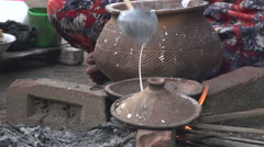 Woman makes pancakes on fire in the streets of Bagan Stock Footage