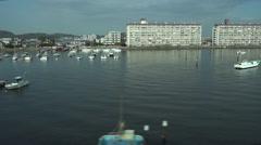 Elevated tracking shot of a boat harbor in Yokohama Japan - stock footage