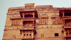 Jaisalmer Fort's sandstone wall with its elaborately sculpted balconies. Stock Footage