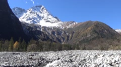 Beautiful snow mountain and rock area caused by mudslides Stock Footage