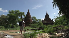 Pagoda in Bagan, photographer takes pictures Stock Footage