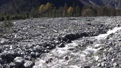 Small stream in rock area caused by mudslides Stock Footage