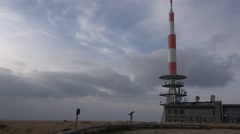 4k Mountaintop Harz Brocken peak with buildings pan Stock Footage