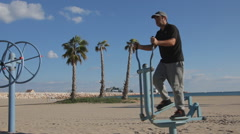 Young Man Exercising On Cross Trainer Stock Footage