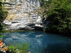 Little blue lake in the middle of the caucasus mountains Stock Photos