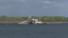 Sand dredger in sand and gravel lake Gieseplas,RHEDERLAAG, THE NETHERLANDS Stock Footage