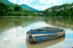 Boat in river on the picturesque landscape Stock Photos
