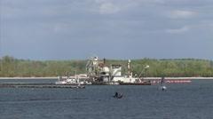 Sand dredger in sand and gravel lake Gieseplas + recreational boats RHEDERLAAG Stock Footage