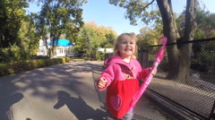 Baby girl running in park - stock footage