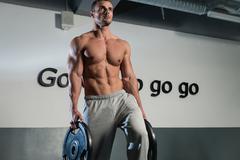 Man Doing Abs Exercise - stock photo