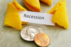 fortune cookie with recession message and coins - stock photo