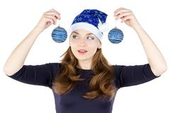 portrait of young woman looking at christmas balls - stock photo