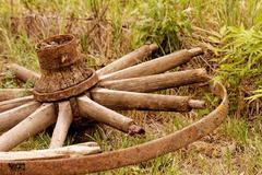 Old broken wagon wheel Stock Photos