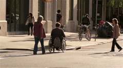 Wheelchair Bound Man Crossing Street Wheeling Disabled Injured Crosswalk NYC Stock Footage