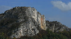 Crows circling menacing cliff Stock Footage