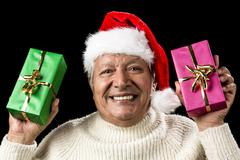 hilarious senior offering green and pink gift - stock photo