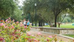 Two Ladies Exploring Hermann Park in Houston TX Stock Footage