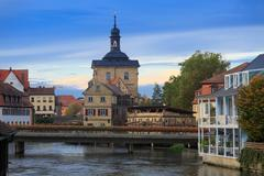 Bridges, altes rathaus and cloudy sky in bamberg Stock Photos