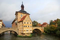 obere bridge (brücke) and altes rathaus and cloudy sky - stock photo