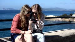 Young ladies with camera Stock Footage