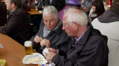 German Couple Eating and Drinking Beer Stock Footage