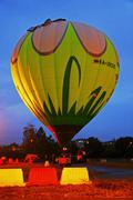 Hot air baloon starting to fly in the evening sky Stock Photos