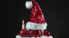 Santa hat on a pair of red boots Stock Footage