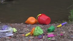 Toys on riverbed 02 Stock Footage
