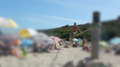 Slackline performance on crowded beach selective focus. - stock footage