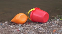 Toys on riverbed Stock Footage