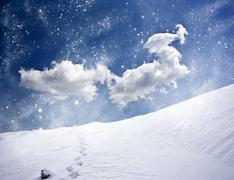 Winter landscape with snow covered hill and blue sky Stock Photos