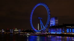 London south bank at night with London Eye time lapse wide Stock Footage