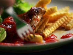 Eating meal consisting of french fries and meat NTSC Stock Footage