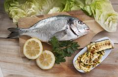 Sea bream and courgette Stock Photos